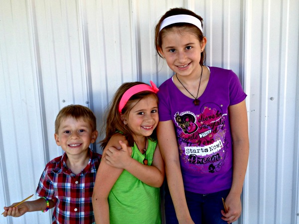 three kids posing for a picture