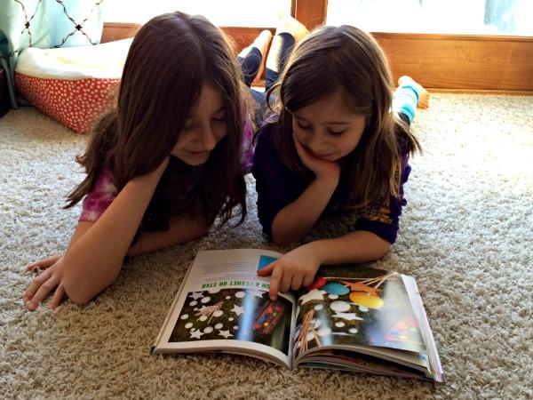 girls reading together